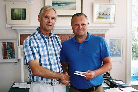 Geoff Storer receives his prize from Martin Poole